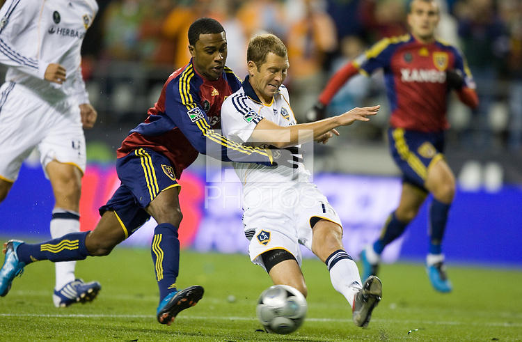 Robbie Findley, left and Greg Berhalter, right, battle for a ball as Real Salt Lake defeats the Los Angles Galaxy 5-4 on penalty kicks to win the 2009 MLS Cup at Qwest Field, Sunday, Nov. 22, 2009.