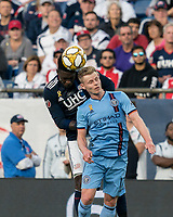 FOXBOROUGH, MA - SEPTEMBER 29: Jalil Anibaba #3 of New England Revolution and Gary Mackay-Steven #17 of New York City FC battle for head ball during a game between New York City FC and New England Revolution at Gillette Stadium on September 29, 2019 in Foxborough, Massachusetts.