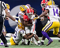 ATLANTA, GA - DECEMBER 7: Brian Herrien #35 of the Georgia Bulldogs is stopped after a short gain by Tyler Shelvin #72 and JaCoby Stevens #3 of the LSU Tigers during a game between Georgia Bulldogs and LSU Tigers at Mercedes Benz Stadium on December 7, 2019 in Atlanta, Georgia.