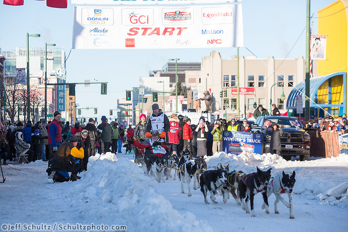 Andrew Nolan and team leave the ceremonial start line with an Iditarider and handler at 4th Avenue and D street in downtown Anchorage, Alaska on Saturday March 4th during the 2017 Iditarod race. Photo © 2017 by Brendan Smith/SchultzPhoto.com.