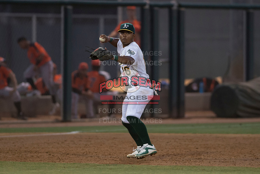 AZL Athletics third baseman Cobie Vance (16) prepares to make a throw to first base during an Arizona League game against the AZL Giants Orange at Lew Wolff Training Complex on June 25, 2018 in Mesa, Arizona. AZL Giants Orange defeated the AZL Athletics 7-5. (Zachary Lucy/Four Seam Images)