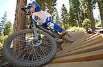 Reno freerider Jason Blanchard rides an elevated banked bridge on a trail at the mountain bike park at Northstar at Tahoe.