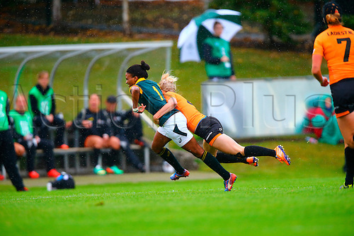 23.08.2015. Dublin, Ireland. Women's Sevens Series Qualifier 2015. Netherlands versus South Africa. Jacqueline Kriel (South Africa) is tackled by Paula Christina Schouten (Netherlands).