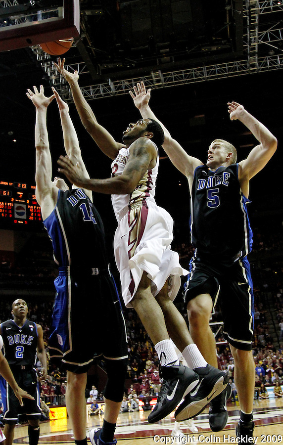 TALLAHASSEE, FL 1/12/10-FSU-DUKE MBB11 CH-Florida State's Derwin Kitchen shoots between Duke's Kyle Singler, left, and Mason Plumlee during second half action Wednesday at the Donald L. Tucker Center in Tallahassee. The Seminoles beat the Blue Devils 66-61...COLIN HACKLEY PHOTO