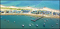 BNPS.co.uk (01202 558833)<br /> Pic: StephenBath/BNPS<br /> <br /> Mudeford spit.<br /> <br /> Britain's most expensive beach hut?<br /> <br /> A luxury beach hut has gone on the market for &pound;280,000 - despite having no running water, mains electricity or toilet.<br /> <br /> The wooden cabin is on the exclusive Mudeford Spit in Christchurch, Dorset, which is home to the most expensive beach huts in the country.<br /> <br /> The price tag on this one beats the previous highest at the same sandy spit, Hut 128 - a similar cabin which sold for &pound;275,000 earlier this year.<br /> <br /> The remote sandbank can only be accessed by foot, novelty land train or ferry but its isolated position is what gives it its exclusivity.