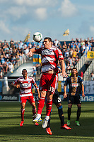 Kenny Cooper (33) of FC Dallas heads the ball. The Philadelphia Union and FC Dallas played to a 2-2 tie during a Major League Soccer (MLS) match at PPL Park in Chester, PA, on June 29, 2013.