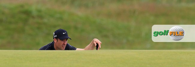 Ross FISHER (ENG) lines up his putt at the 14th green during Sunday's Round  of the 144th Open Championship, St Andrews Old Course, St Andrews, Fife, Scotland. 19/07/2015.<br /> Picture Eoin Clarke, www.golffile.ie