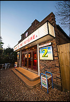 BNPS.co.uk (01202 558833)<br /> Pic: PhilYeomans/BNPS<br /> <br /> Field of Dreams....<br /> <br /> Film buff Andy Jones has built an ABC cinema in his back garden as a lasting tribute to the now defunct movie company.<br /> <br /> Andy, 38, has taken four and a half years and spent &pound;70,000 of his life savings building the 34-seat cinema from scratch.<br /> <br /> The father-of-two's movie house mirrors cinemas of the 1930s with big red curtains, red seats and a parquet floor in the projection room. <br /> <br /> The brick building, which is adorned with an ABC sign, is 40ft tall, 22ft wide and 20ft high and takes up half of the garden of his three bed semi-detached house.<br /> <br /> The theatre, which has a 17ft by 7ft screen, has its own projection room, black and white old-style toilets and a foyer with a concessions stand that offers popcorn and sweets.