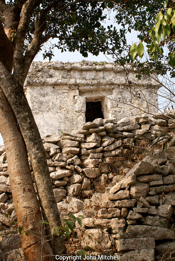 Watchtower and stone wall, at the Mayan ruins of Tulum on the Riviera Maya, Quintana Roo, Mexico.