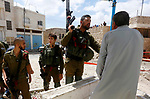 Israeli soldiers gather at the scene of what the Israeli military said was car-ramming attacks by a Palestinian man in the West Bank city of Hebron on June 2, 2018. The Israeli army shot dead Rami Sabarneh, 36, in the Jabir neighborhood near the Ibrahimi Mosque in the Old City of Hebron, Palestinian health ministry said. Photo by Wisam Hashlamoun
