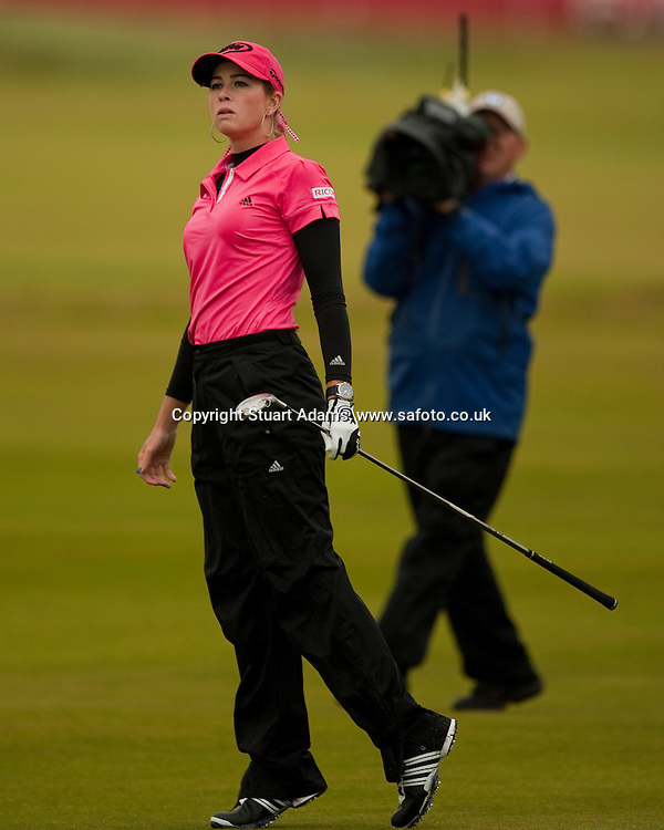 Paula Creamer in her distinctive pink watches her hybrid shot to the par 5 17th hole during the first round play of the  Ricoh Woman's British Open to be played over the Championship Links from 28th to 31st July 2011; Picture Stuart Adams, SAFOTO. www.safoto.co.uk; 28th July 2011