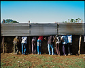 21/01/12. Bahir Dar, Ethiopia. Young men watch a local college football match, for free, through the fence. Photo credit: Jane Hobson.