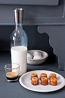Small cakes and a contemporary flask of fresh milk are prepared for breakfast