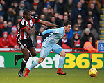 Clayton Donaldson of Sheffield Utd  and Bryan Oviedo of Sunderland during the Championship match at Bramall Lane Stadium, Sheffield. Picture date 26th December 2017. Picture credit should read: Simon Bellis/Sportimage