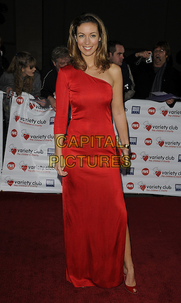 EMMA CROSBY.At the Variety Club Showbiz Awards held at the Grosvenor House Hotel, Park Lane, London, England..November 15th 2009.full length dress one shoulder red sleeve slit split clutch bag.CAP/CAN.©Can Nguyen/Capital Pictures.