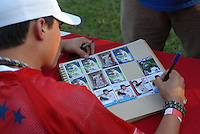 Wilmer Flores of the Savannah Sand Gnats signs autographs at the 2010 South Atlantic League All-Star Game welcome party and festivities Monday night June 21, 2010, at the Wyche Pavilion along the Reedy River in Greenville, S.C. Photo by: Tom Priddy/Four Seam Images