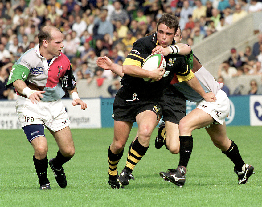 Photo: Richard Lane.Harlequins v Wasps. Zurich Premiership. 9/9/2000.Matt Leek is tackled by Will Greenwood as Matt Burke looks on..