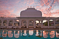 Dawn light reflection of marble arcade with carved columns and graceful arches in swimming pool of Taj Lake Palace. (Photo by Matt Considine - Images of Asia Collection)