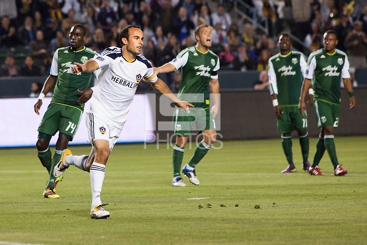 LA Galaxy captain Landon Donovan (10) begins the celebratation after scoring his PK. The LA Galaxy defeated the Portland Timbers 3-0 at Home Depot Center stadium in Carson, California on  April  23, 2011....