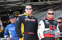 Apr 25, 2009; Talladega, AL, USA; NASCAR Nationwide Series driver Danny O'Quinn Jr. (center) stands alongside Robert Richardson Jr. (right)  prior to the Aarons 312 at the Talladega Superspeedway. Mandatory Credit: Mark J. Rebilas-