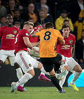 Victor Lindelöf of Man Utd and teammates fail to stop Rubén Neves of Wolves goal during the Premier League match between Wolverhampton Wanderers and Manchester United at Molineux, Wolverhampton, England on 19 August 2019. Photo by Andy Rowland.