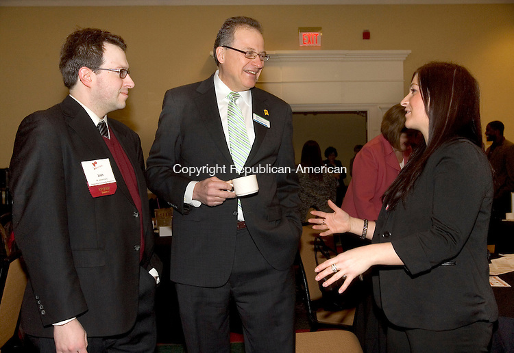 WATERBURY CT. 24 January 2014-012414SV02-From left, Joshua Carey, Connecticut Community Foundation, Charles J. Boulier III, president and CEO of Naugatuck-based Ion Bank, and Courtney Ligi, Special Events Director and YPOWR Director for the Waterbury Regional Chamber, talk before Boulier speaks during the Waterbury Regional Chamber's Young Professionals Organization of Waterbury Region, YPOWR, at a breakfast in Waterbury Friday.<br /> Steven Valenti Republican-American