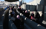 Palestinians make their way through the Israeli Qalandia checkpoint, in the occupied West Bank between Ramallah and Jerusalem, to attend Friday prayer of the holy fasting month of Ramadan in Jerusalem's al-Aqsa mosque, on June 16, 2017. Photo by Prime Minister Office