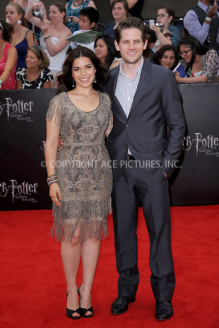 WWW.ACEPIXS.COM . . . . . .July 11, 2011...New York City...America Ferrera with husband Ryan Piers Williams attend the New York premiere of 'Harry Potter And The Deathly Hallows: Part 2' at Avery Fisher Hall, Lincoln Center on July 11, 2011 in New York City...Please byline: KRISTIN CALLAHAN - ACEPIXS.COM.. . . . . . ..Ace Pictures, Inc: ..tel: (212) 243 8787 or (646) 769 0430..e-mail: info@acepixs.com..web: http://www.acepixs.com .