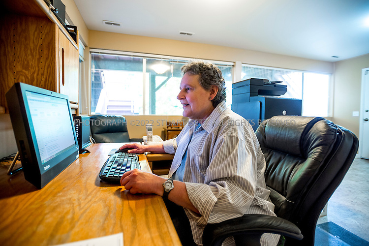 5/24/2015&mdash;Newcastle, WA<br /> <br /> SEC whistleblower Yolanda Holtzee, 59, in her home in Newcastle, WASH., near Seattle. <br /> <br /> Photograph by Stuart Isett for The Wall Street Journal.<br /> Slug: WHISTLEBLOWER