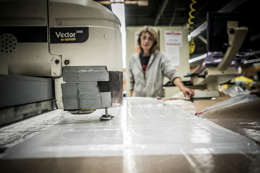 First step in the Stormy Kromer manufacturing process cutting the hat pieces from bolts of wool fabric at the Ironwood, Michigan production facility.