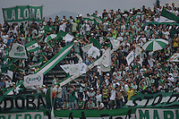 MEDELLÍN -COLOMBIA-23-08-2014. Seguidores  de Atlético Nacional muestran apoyo a su equipo durante partido con Envigado FC por la fecha 6 de la Liga Postobón II 2014 jugado en el estadio Atanasio Girardot de la ciudad de Medellín./ Atletico Nacional followers show support to their team during match against Envigado FC for the 6th date of the Postobon League II 2014 at Atanasio Girardot stadium in Medellin city. Photo: VizzorImage/Luis Ríos/STR