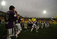 The teams take the pitch before kickoff during the A-League football match between Wellington Phoenix and Perth Glory at Westpac Stadium, Wellington, New Zealand on Sunday, 16 August 2009. Photo: Dave Lintott / lintottphoto.co.nz
