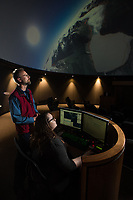 Computer Science & Engineering Assistant Professor Frank Witmer works with Planetarium Manager Omega Smith as they use the UAA Planetarium for visualization of Witmer's work on the Alaska EPSCoR Southcentral Test Case project, which analyzes drivers of change in the Kenai River watershed.