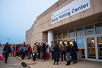 A line forms early in the morning at a Columbus, Ohio, early voting center on the first day of early voting in the state.