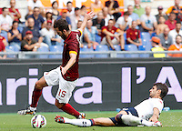 Calcio, Serie A: Roma vs Cagliari. Roma, stadio Olimpico, 21 settembre 2014.<br /> Roma midfielder Miralem Pjanic, of Bosnia, is tackled by Cagliari defender Luca Rossettini, right, during the Italian Serie A football match between AS Roma and Cagliari at Rome's Olympic stadium, 21 September 2014.<br /> UPDATE IMAGES PRESS/Riccardo De Luca