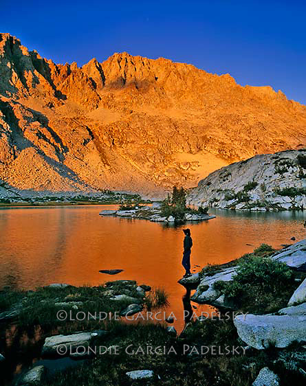 Silhouetted cowboy and mountain alpenglow  reflection. Sierra Nevada, Kings Canyon National Park, California