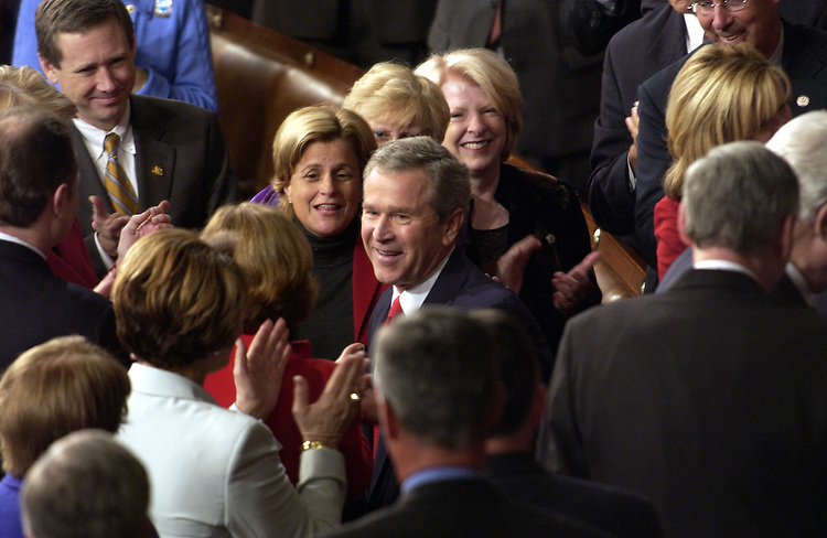 President George W. Bush greets members of Congress before his State of the Union address.
