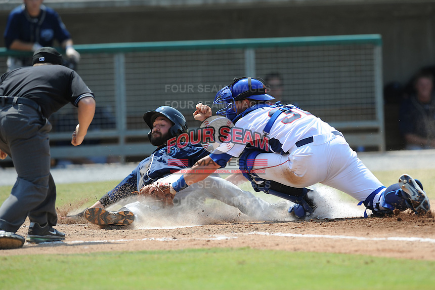 Tennessee Smokies Blake Lalli #32 puts the tag on Taylor Harbin as he attempts to avoid the tag during a game against the Mobile BayBears at Smokies Park in Kodak,  Tennessee;  May 22, 2011.  The Smokies won the game 4-2.  Photo By Tony Farlow/Four Seam Images