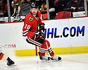 PATRICK SHARP,  of the Chicago Blackhawks in action  during the Blackhawks game against the Calgary Flames at the United Center in Chicago, IL.  The Chicago Blackhawks beat the Calgary Flames 4-2 in Chicago, Illinois on December 5, 2011....