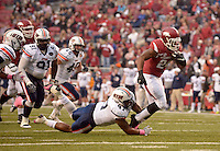 NWA Democrat-Gazette/BEN GOFF @NWABENGOFF<br /> Deantae Glover, UT-Martin defensive end, tackles Kody Walker, Arkansas running back, in the third quarter on Saturday Oct. 31, 2015 during the game in Razorback Stadium in Fayetteville.