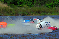 Jimmy Robb (#31) and Bud Nollman, (#5) come together in turn one. (SST-45 class)