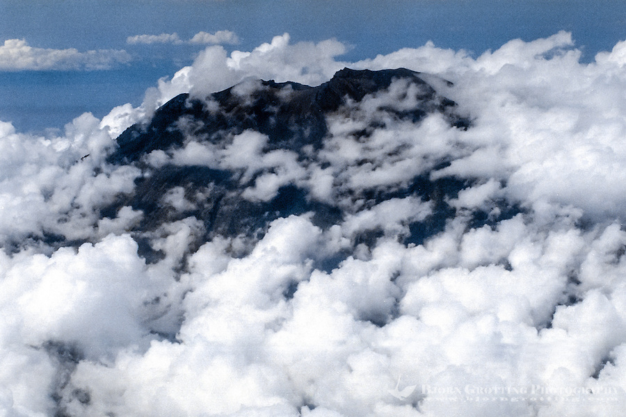 Bali, Karangasem, Gunung Agung. The summit of Gunung Agung covered by clouds (from airplane).