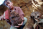 Forensic Anthropologists exhume a mass grave in the Guatemalan highland village of Chacalte in September of 1997. Over 500,000 people dissapeared or fled the country during the 36-year civil war. Work has now began locating and identifying the hundreds of mass grave sites that litter the country.