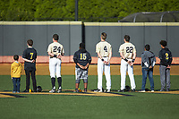 (L-R) Wake Forest Demon Deacons outfielders Chris Lanzilli (24), D.J. Poteet (4), and Michael Ludowig (22) are joined on the field by youth baseball players for the National Anthem prior to the game against the Liberty Flames at David F. Couch Ballpark on April 25, 2018 in  Winston-Salem, North Carolina.  The Demon Deacons defeated the Flames 8-7.  (Brian Westerholt/Four Seam Images)