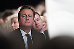© Joel Goodman - 07973 332324 . No syndication permitted . 29/09/2013 . Manchester , UK . DAVID CAMERON sits in the audience as Grant Shapps speaks . Day 1 of the Conservative Party Conference at Manchester Central . Photo credit : Joel Goodman