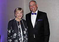 NWA Democrat-Gazette/CARIN SCHOPPMEYER Jane Hunt and Larry Shackelford visit at the Washington Regional Eagle Awards Gala.