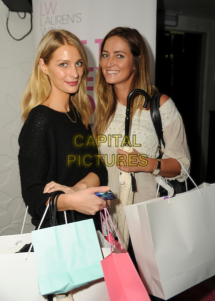 Olivia &amp; Francesca Newman-Young<br /> 'Bloggers Love' Gifting Suite Event at the Penthouse, Leicester Square. London, England.<br /> 17th September 2013<br /> half length black white dress bags shopping<br /> CAP/PP/GM<br /> &copy;Gary Mitchell/PP/Capital Pictures