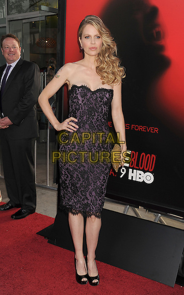 Kristin Bauer van Straten<br /> HBO's &quot;True Blood&quot; Season 6 Premiere Held At ArcLight Cinemas Cinerama Domee, Hollywood, California, USA.<br /> June 11th, 2013<br /> full length dress lace black strapless purple hands on hips<br /> CAP/ROT/TM<br /> &copy;Tony Michaels/Roth Stock/Capital Pictures