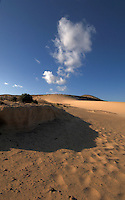 White cloud above sand dunes, Playa de Sotavento de Jandia, Fuerteventura, Canary Islands,Spain.