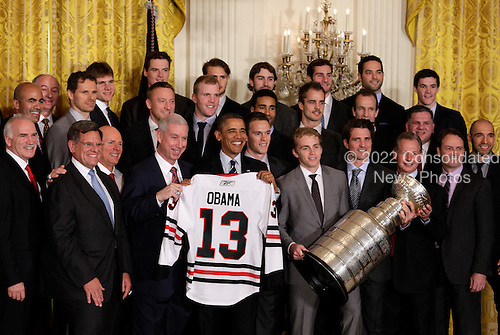 United States President Barack Obama holds a jersey as he honors the 2013 Stanley Cup Champion Chicago Blackhawks at the White House in Washington, November 4, 2013. <br /> Credit: Yuri Gripas / CNP